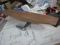 Name: IMG_6168.jpg Views: 663 Size: 227.7 KB Description: After some razor plane action and lots of sanding, the hull in its final shape.