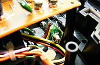 Name: DSCF6089c.jpg Views: 451 Size: 75.3 KB Description: Note how wires are hot glued to PCB and case. Tiewrap + and PPM wires.