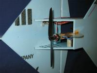 Name: 004.jpg Views: 630 Size: 52.6 KB Description: Motor mounting along with temporary skid. Also visible is the location hole for the nose gear yet to be installed.