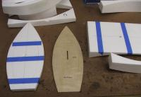 Name: kittie_04.jpg Views: 374 Size: 74.3 KB Description: Next I used the foam core to trace a basic outline onto the hull bottom.  That way I could keep all the glue in the right places. :)