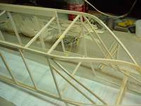 Name: DSC03344 copy.jpg Views: 296 Size: 77.1 KB Description: Cargo doors were troublesome. I actually redid this once since the balsa didn't take to being bent so tightly, even after soaking. I wound up slicing the end to allow it to bend without breaking. Fair results...
