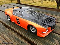 Name: Camaro Protoform Z28 Rally Orange Black 1R.jpg Views: 3 Size: 345.3 KB Description: Vintage Trans Am Camaro.  Associated TC3 chassis, Novak 25.5 brushless motor, HPI body.