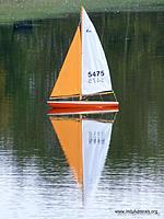 "Name: SeptemberRegatta2012 005R.jpg Views: 66 Size: 98.5 KB Description: Scott's ""Sunkist"" hull in orange and white.  Neat photo."