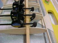 Name: Indy40027.jpg Views: 218 Size: 71.2 KB Description: Clamps for dihedreal brace.