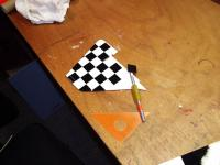 """Name: Indy40042.jpg Views: 239 Size: 83.3 KB Description: I covered the Fin/Rudder with white Ultracote and then made a grid using a yellow grease pencil to attach my 1"""" x 1"""" squares to.  You don't have to do the checkerboard, but it is the """"Signature"""" look of this plane and I swear it w"""