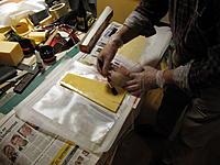 Name: glasarbejder 007.jpg Views: 131 Size: 189.0 KB Description: newspaper , Baking paper, 49 gram/m� the foam profileand me applying  Epoxy.