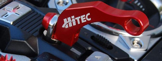 Hitec has just released this attractive neck strap balance.  This attaches to the existing strap eyelet and will perfectly balance the transmitter when used with the 2.4GHz module.