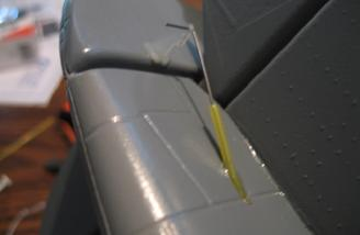 A small hole hand-drilled into the tail for the flexible tube. I use a thin wire pushrod in the tube.