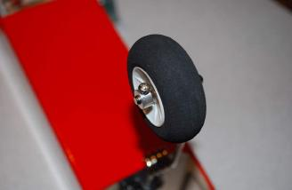 The aluminum collar for secures the wheel. A flat spot on the wire is nice for more grip for the collar set screw.