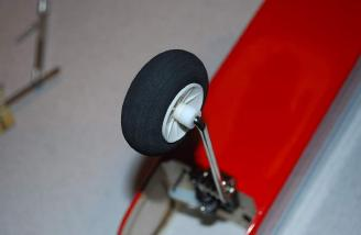 A nylon spacer keeps the wheel in the center of the gear leg. This relieves side-to-side pressure on the nose gear steering.