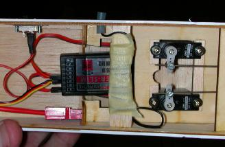 The instructions recommend coiling the receiver antenna.  I did this, making sure none of the loops overlapped.  Then I taped the antenna to the balsa stick and glued it to the fuse sides.