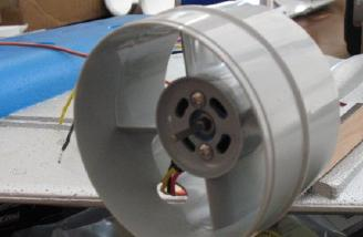 The front of the fan unit mounting the motor.
