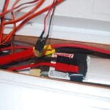 The factory installed a wood battery tray.  I added hook and loop material and E-flite included the hook and loop