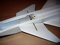"""Name: GripenCanard.jpg Views: 61 Size: 231.5 KB Description: Here is a simple, proven system for constructing an all-flying canard. I re-inforced the bearing through the sides of the fuse with clear plastic packing material. 1/32"""" ply is recommended."""