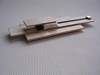 """Name: DSCN0315.jpg Views: 306 Size: 239.4 KB Description: New """"device"""" from left over balsa, that gold thingy at the back is a rare earth magnet."""
