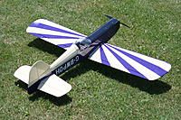 Name: IMG_0035.jpg Views: 394 Size: 312.4 KB Description: Monokote mid purple over ditto cream. The wing underside is plain cream. Black atop the fuselage ahead of the canopy. Can figure out 'this way up' from far enough