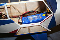 Name: IMG_2734.jpg Views: 575 Size: 175.7 KB Description: Battery location on my 1/6th. The top window is left off for flight, the bottom door magnetically latches shut for flight. This is the battery's flight position, front end against the back face of the kit firewall.