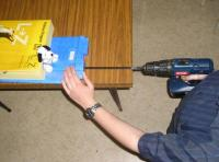 """Name: esam485.JPG Views: 2815 Size: 37.2 KB Description: Drill slowly & steadily into wing, with far end pushed down a little so your drill bit doesn't drill through the bottom of the wing.  Probably worth jacking up wing and """"holding"""" into to correct shape for drilling with phone books on it."""