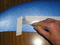 Name: esam630.jpg Views: 2737 Size: 39.9 KB Description: Now for the long cut.  HINT - TAPE the straight edge to the wing before cutting, and hold it FIRMLY, because you don't get a second chance(!!).
