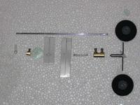 Name: bequilha_004_158.jpg Views: 418 Size: 35.8 KB Description: Here's the set of parts for the nose wheel