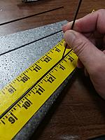 Name: photo5.jpeg Views: 10 Size: 953.9 KB Description: Lay the spars into the adhesive, then make sure to push the spar down into the channel to coat the spar well.