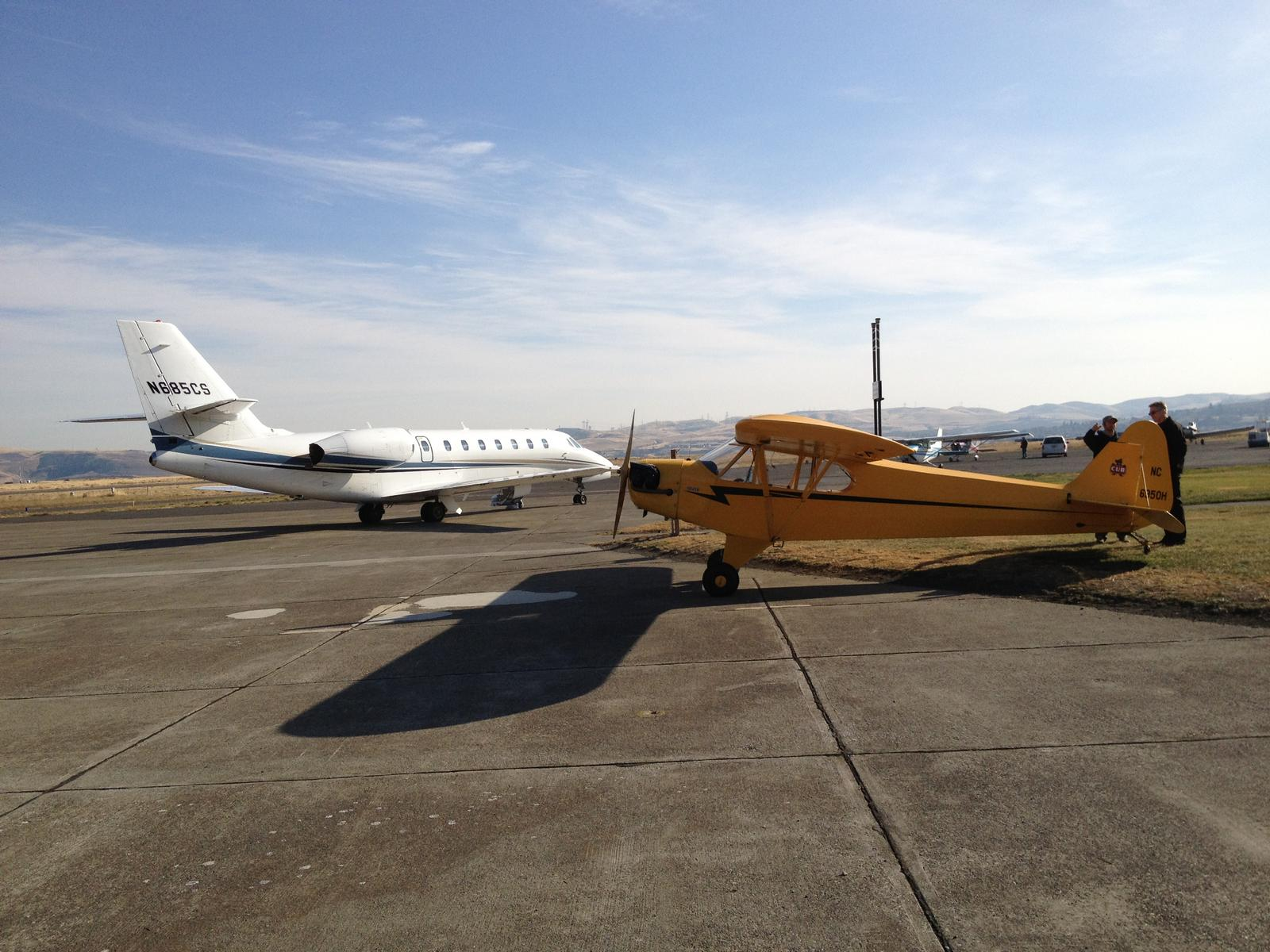 Name: IMG_0210.jpg Views: 259 Size: 224.1 KB Description: Sovereign in the background and my favorite the J3 Cub in the foreground