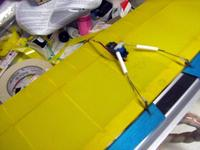 Name: E.jpg Views: 196 Size: 42.1 KB Description: Following the spirit of the mini stick aileron set up. I have mounted the ail. servo to the underside of the wing top sheeting using very aggresive 2 side foam tape.