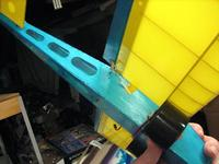 Name: J.jpg Views: 148 Size: 45.3 KB Description: Side view of control arms. The ugly gaping hole is a tradeoff for a nice smooth top. I have a feeling Dave has already addressed this issue with an innovative fix.